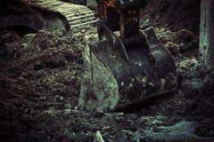 Excavator bucket closeup .Excavation, channel Royalty Free Stock Image