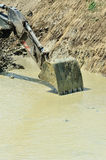 Excavator bucket collect water Royalty Free Stock Image