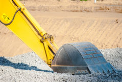 Excavator bucket. On crushed stone, building site Royalty Free Stock Images