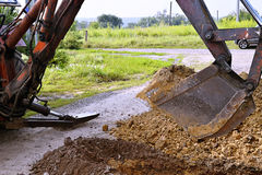 Excavator arm scoop digging stock images download 167 photos for Digging ground dream meaning