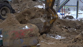 Excavator bucket digs the ground stock footage