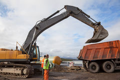 Excavator bucket on a dump truck lifted Stock Photography