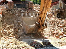 Excavator bucket dumping. Works after the demolition of the building Stock Photography