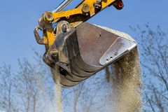 Excavator bucket with gravel Royalty Free Stock Images