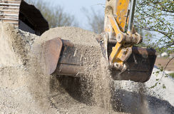 Excavator bucket with gravel Stock Photos