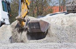 Excavator bucket with gravel Stock Photo
