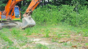 Excavator bucket leveled the ground stock video footage