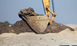 Excavator bucket loaded with erath Royalty Free Stock Photography