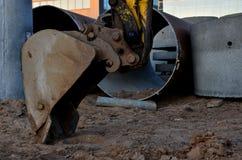 Excavator bucket in the sandy ground, earthworks concept. Iron excavator bucket in the sandy ground, earthworks concept royalty free stock photography