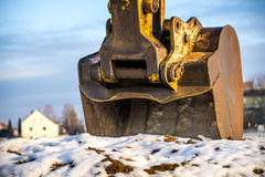 Excavator bucket in snow Royalty Free Stock Images