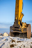 Excavator bucket in snow Royalty Free Stock Photo