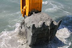 Excavator bucket of water from the soil Royalty Free Stock Photo