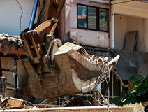 Excavator bucket. Works after the demolition of the building Stock Image