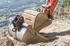 Excavator buckets ready for changing on a hill stock photography