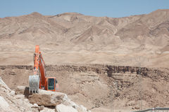 Excavator building a mountain road in the atlas mountain Royalty Free Stock Photo