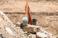Excavator building a mountain road in the atlas mountain Stock Photo
