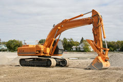 Excavator at building site royalty free stock image