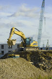 An excavator at building site. An excavator at a construction site Stock Photos