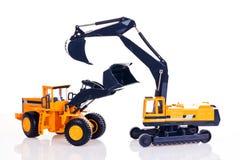 Excavator and bulldozer. Toy excavator and bulldozer isolated on white background Stock Photos