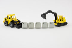 Excavator and bulldozer build. Excavator and bulldozer toy with spelled word build Stock Photography