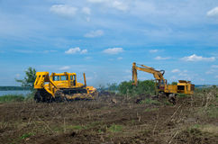 Excavator and bulldozer clearing forest land. Stock Images