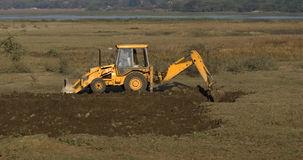 An excavator or bulldozer digging the ground Royalty Free Stock Photo