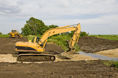 Excavator & Bulldozer on Job Site Stock Photography