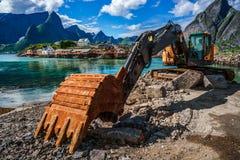 Excavator, bulldozer repair work on the road. Norway Royalty Free Stock Images