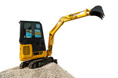 Excavator bulldozer and rocks, isolated on white with clipping p Royalty Free Stock Photography