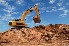 Excavator bulldozer in sandpit Stock Photos