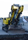 Excavator bulldozer to repair the road surface stock photography