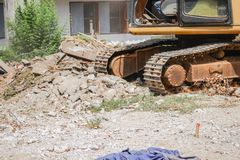 Excavator, bulldozer in work demolition construction Stock Images