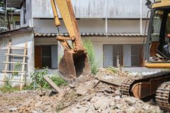 Excavator, bulldozer in work demolition construction Royalty Free Stock Photos