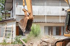 Excavator, bulldozer in work demolition construction Royalty Free Stock Photography