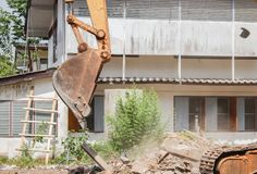 Excavator, bulldozer in work demolition construction Royalty Free Stock Photo