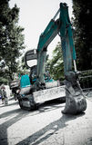 Excavator in a city Stock Photo