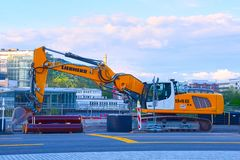 Excavator on a city street in the reconstruction of communications stock photo
