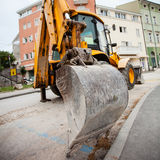 Excavator in a city Royalty Free Stock Photography