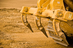 Excavator clamps. And tracks covered in mud. Close up stock photo