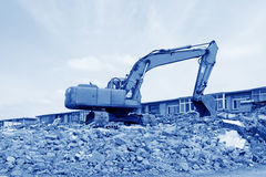 Excavator cleaning construction waste Stock Photos
