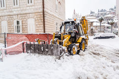 Excavator cleans the streets of large amounts of snow Royalty Free Stock Image