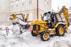 Excavator cleans the streets of large amounts of snow Stock Images