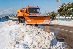 Excavator cleans the streets of large amounts of snow Stock Photo