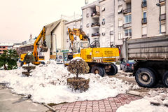 Excavator cleans the streets of large amounts of snow Royalty Free Stock Photography
