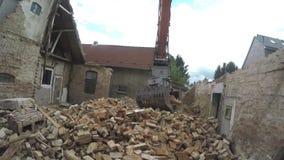 Excavator clearing debris stock video