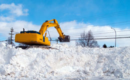 Excavator clearing snow Stock Photos