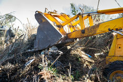 Excavator clearing undergrowth. Close up of a forest fire burning bushes royalty free stock photos