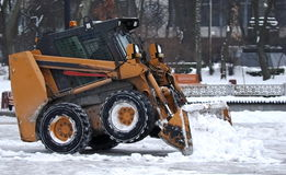 Excavator clears snow Stock Photos