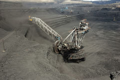 The excavator at the coal face Royalty Free Stock Photography