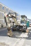Excavator conducting road repair. Stock Images